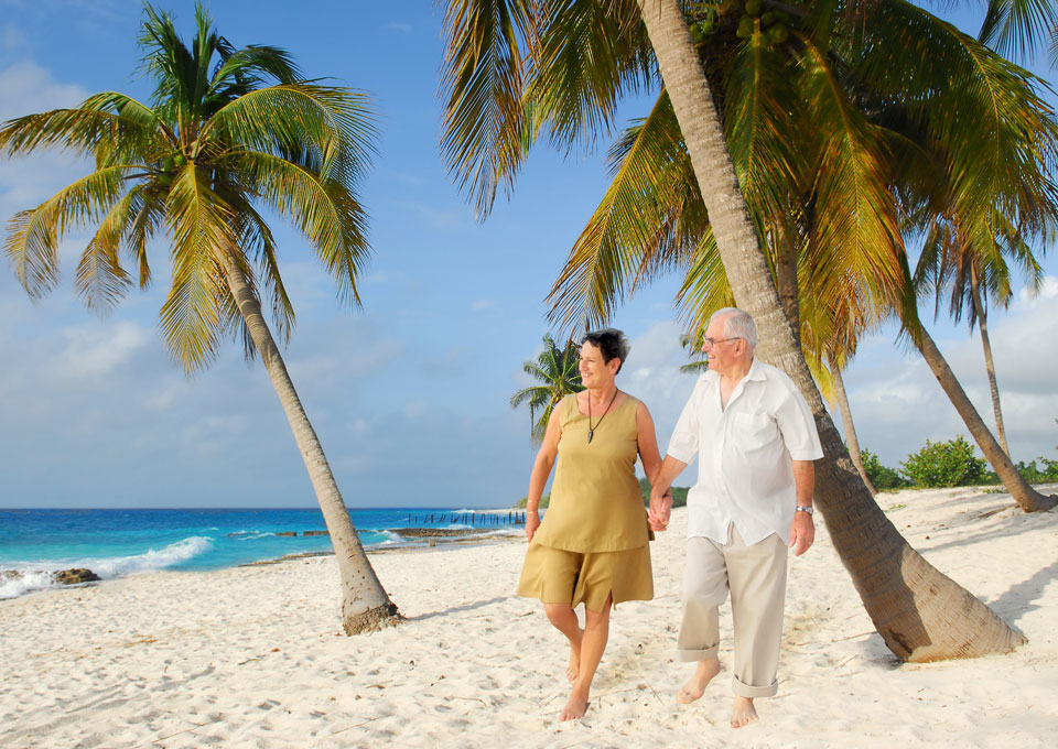 Couple on a beach holiday with travel insurance